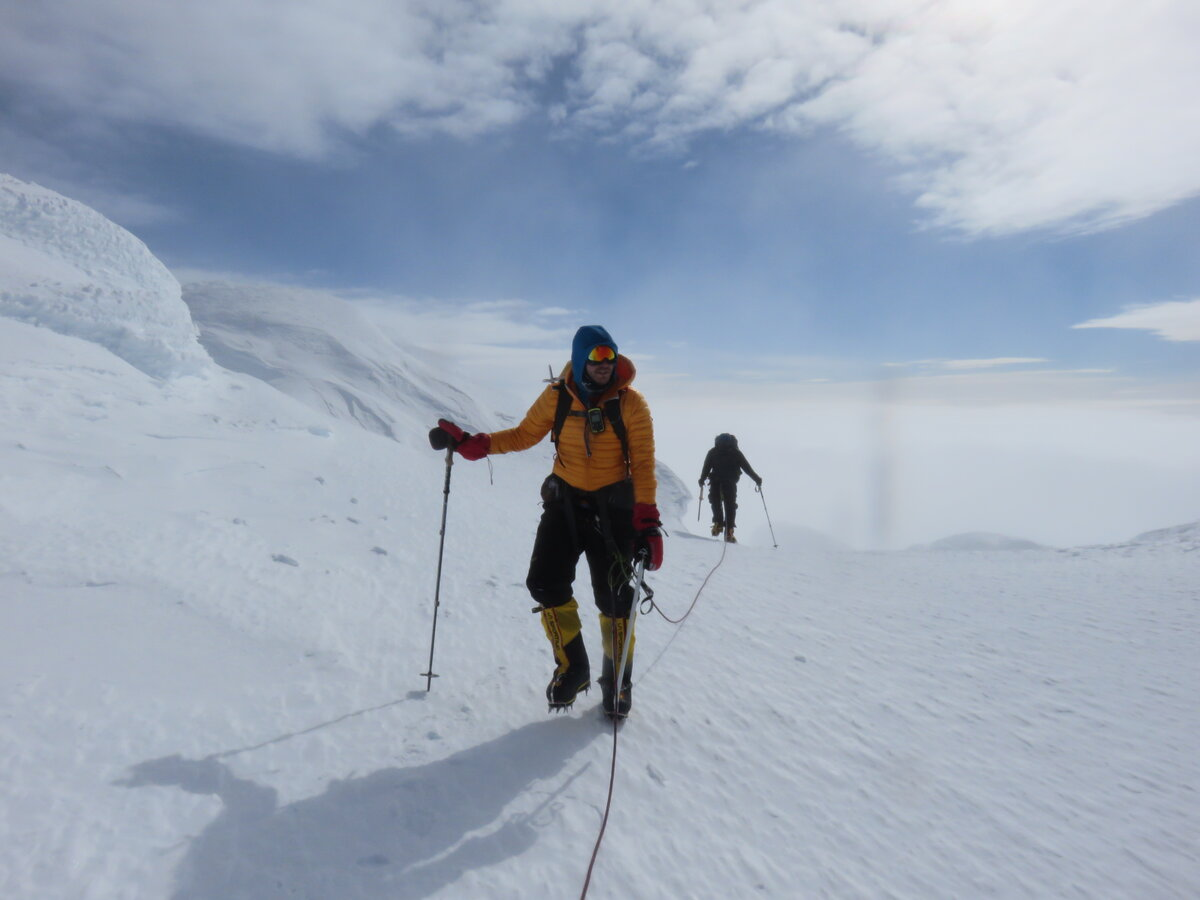 Climbing team travels roped together on the summit ridge
