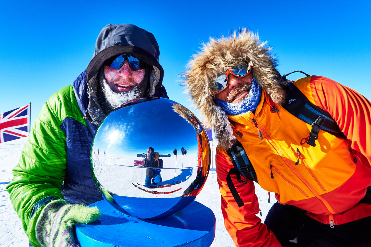 ALE Guide and guest at Ceremonial South Pole