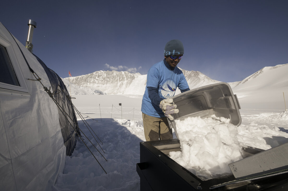 ALE guide Namgya S. fills the snow melter