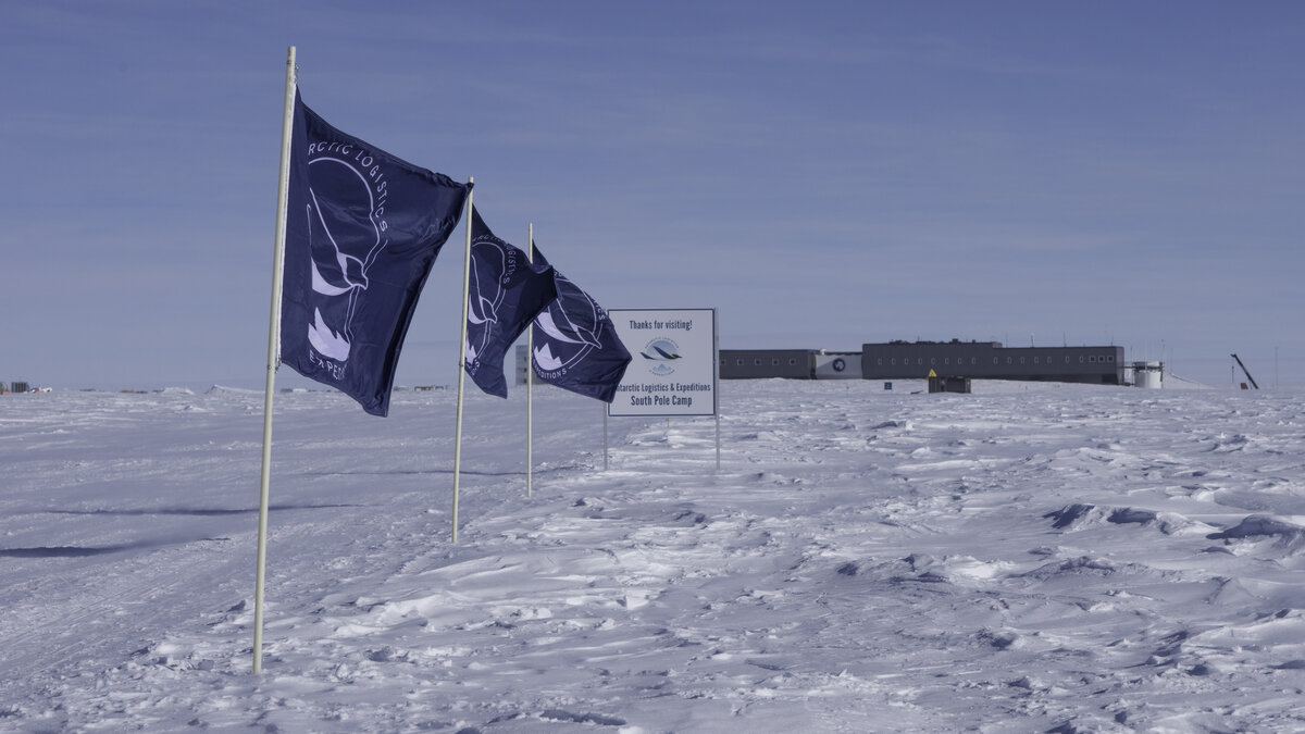 ALE flags and a sign, mark the edge of ALE's South Pole Camp