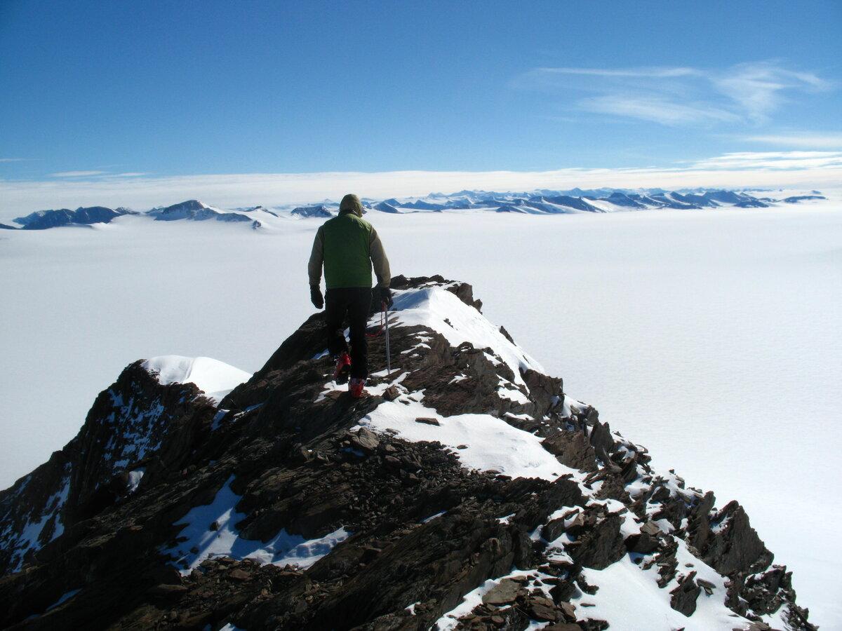 Climber traverses Driscoll Ridge overlooking Schanz Glacier