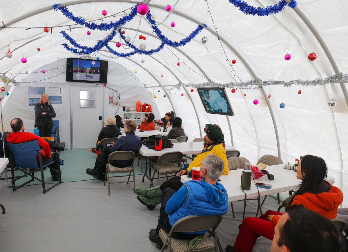 Carol K. gives a lecture to guests at ALE's South Pole Camp