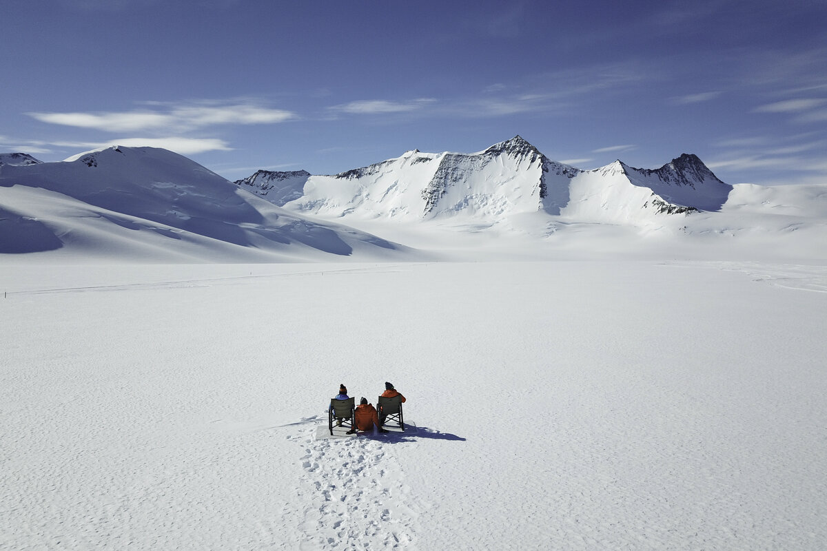 Guests enjoy the view of Mount Sporli from Three Glaciers Retreat