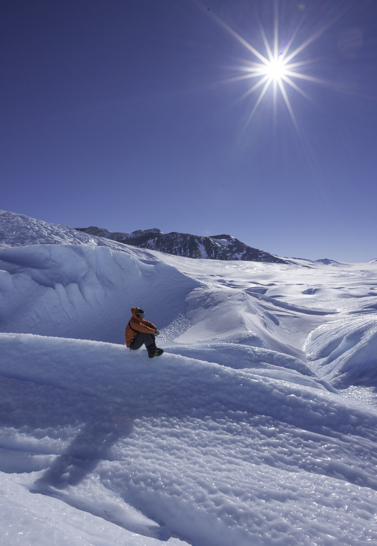A guest contemplates  the scenery at the Drake Icefall