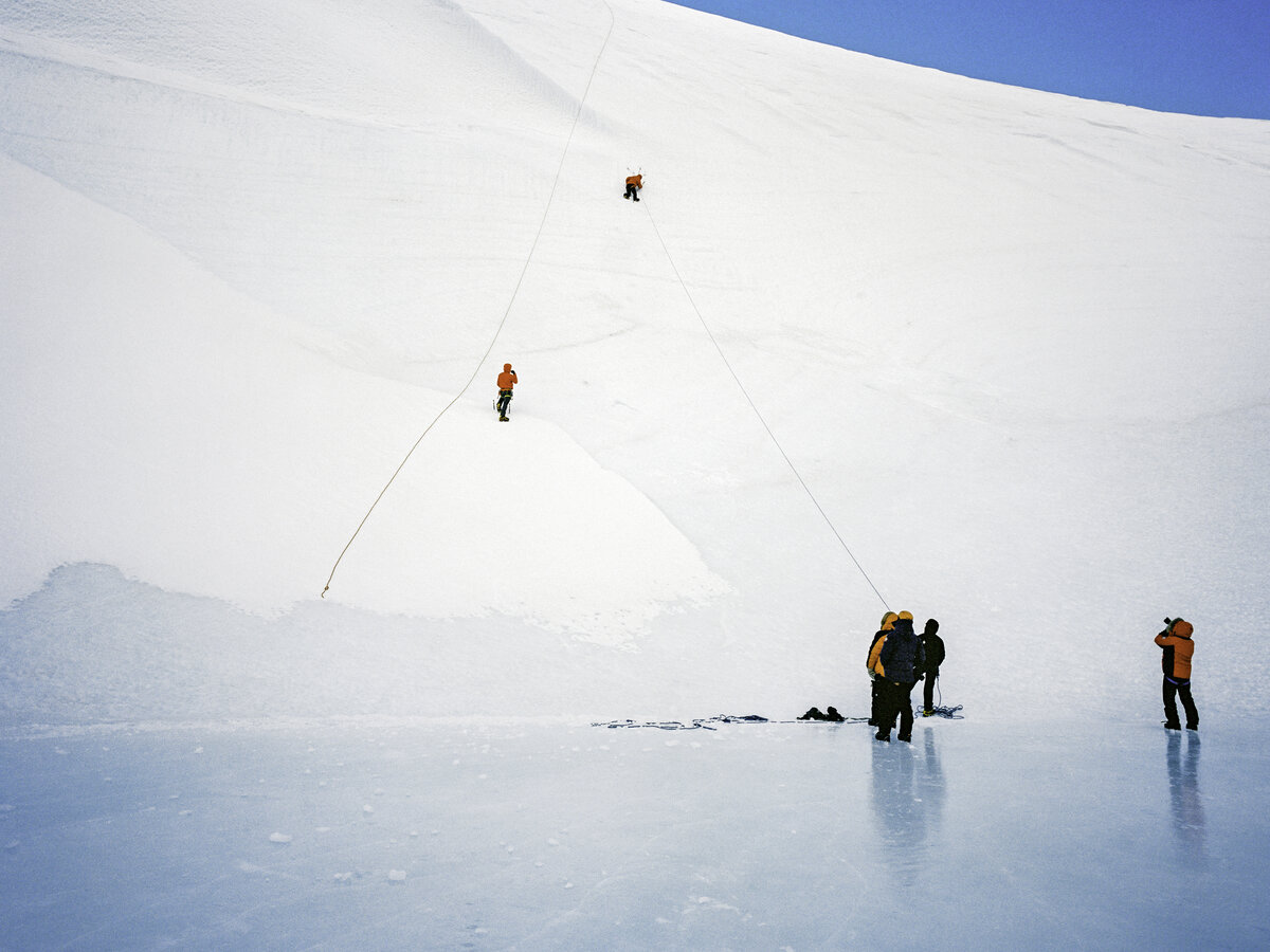 A guest tries ice climbing at the Charles Peak Windscoop