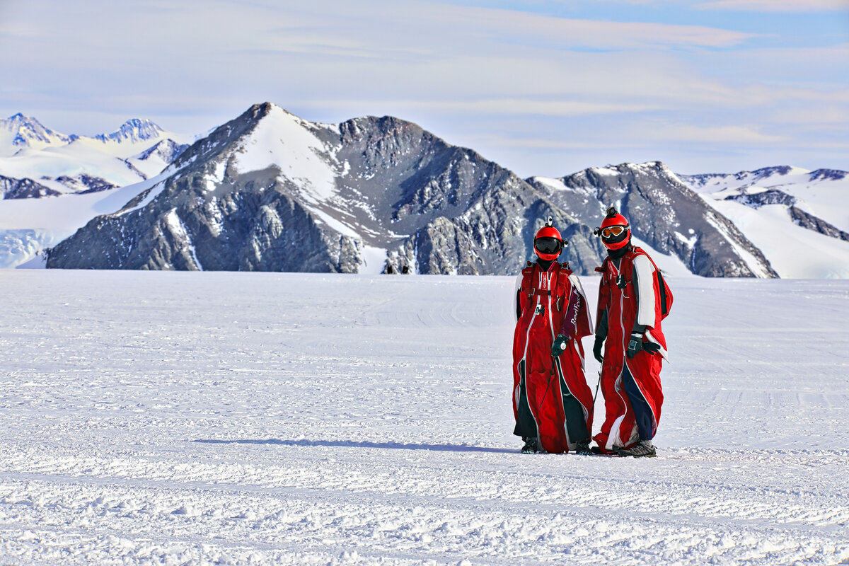 Wingsuiters wait on the skiway before boarding a Twin Otter