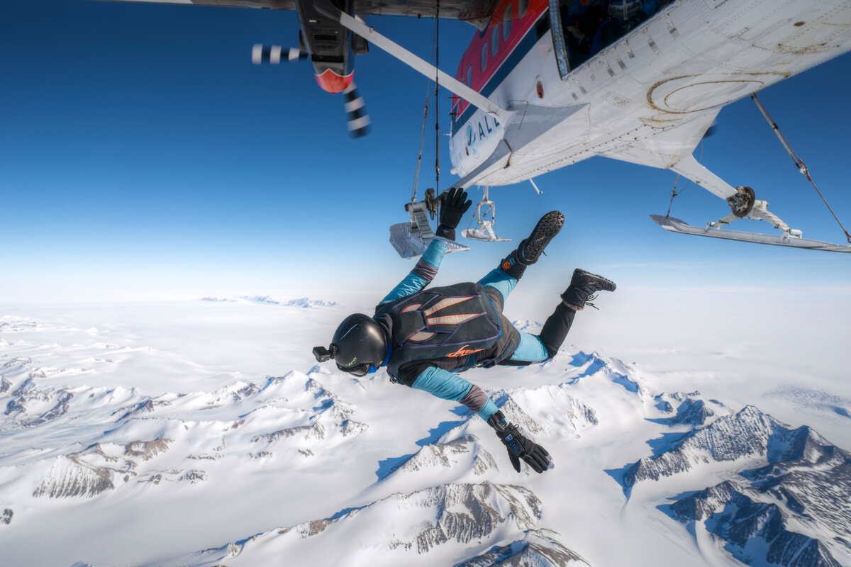 A skydiver jumps from the Twin Otter