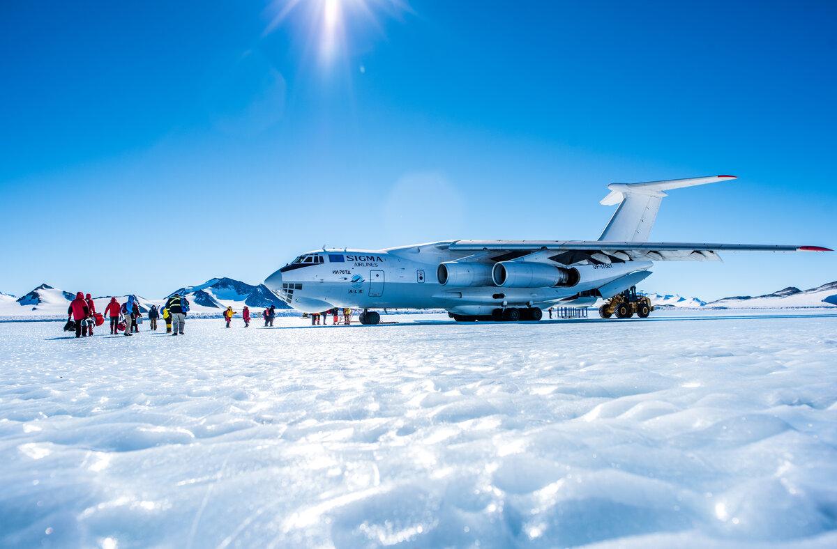 Guests prepare to board the Ilyushin on the Union Glacier blue-ice runway