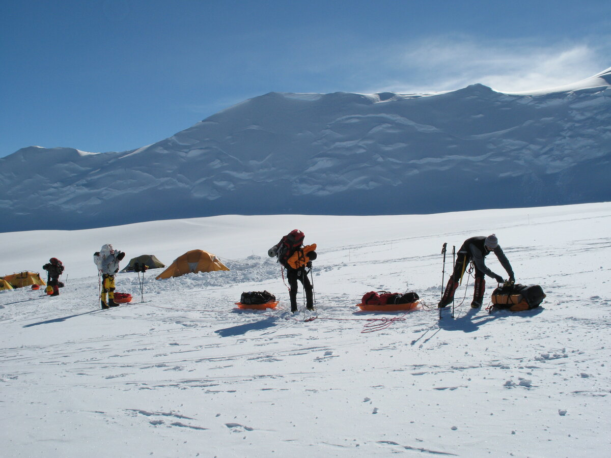 Roped climbers prepare to head out from Vinson Low Camp