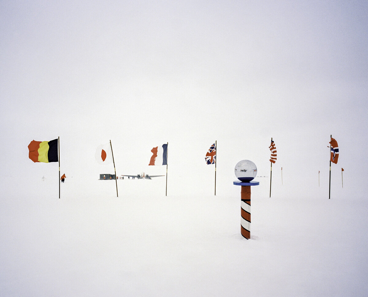 Ceremonial South Pole with Antarctic Treaty nation flags