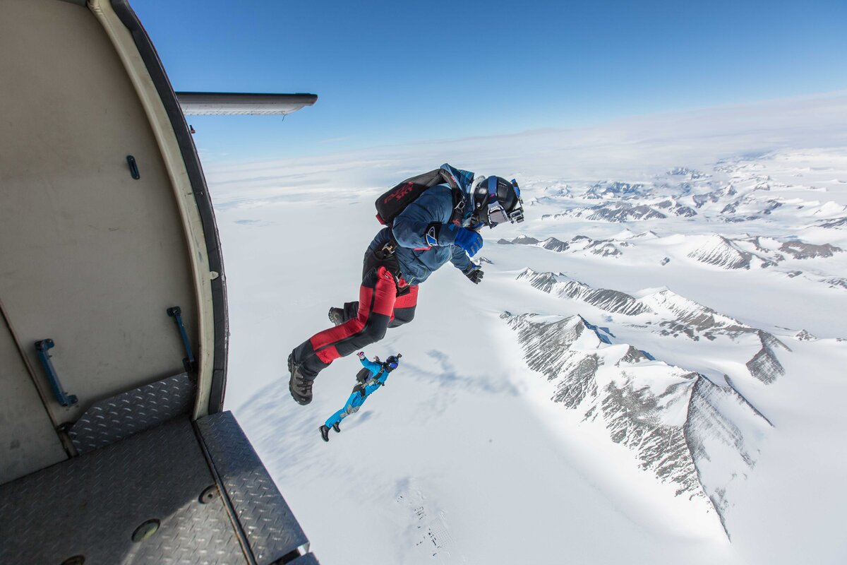 Divers exit a Twin Otter over Union Glacier