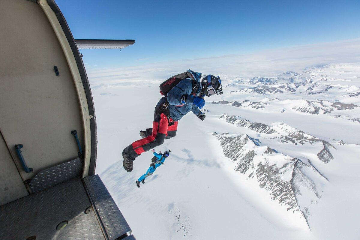 Divers exit a Twin Otter over Union Glacier