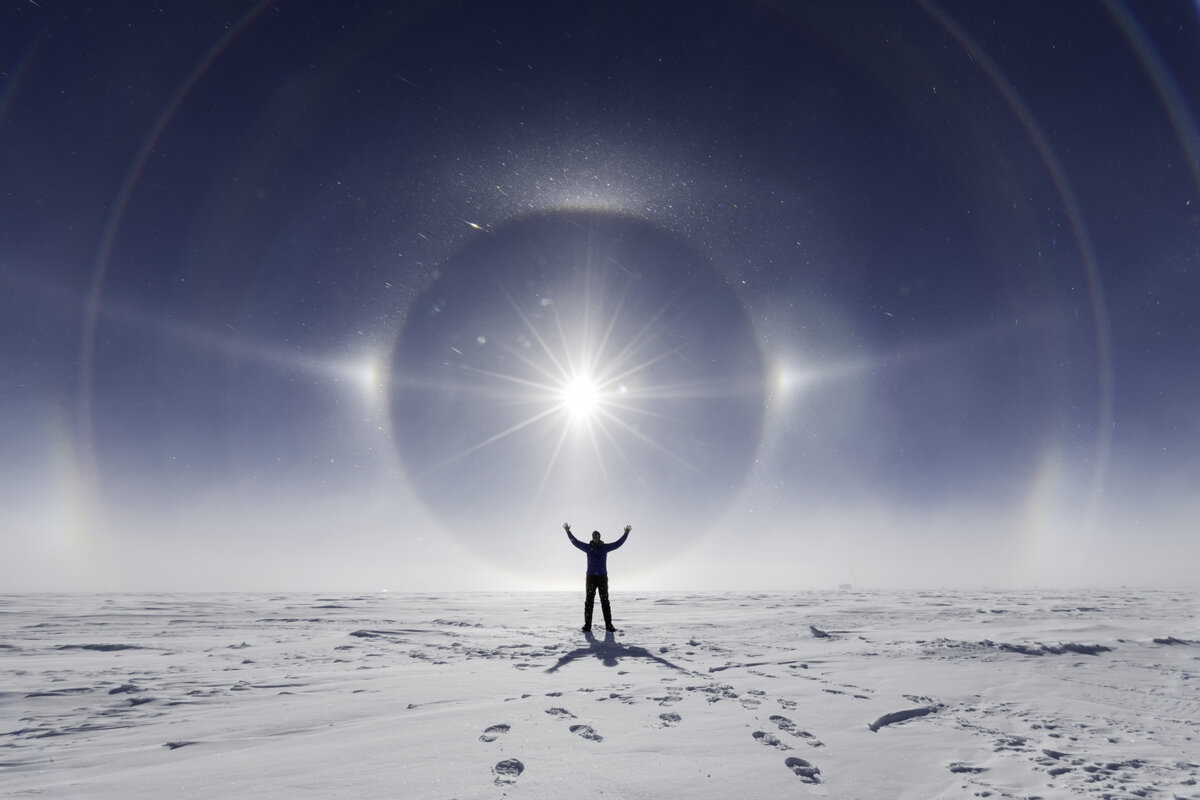 Beautiful sundogs and halos forming around the sun at the South Pole